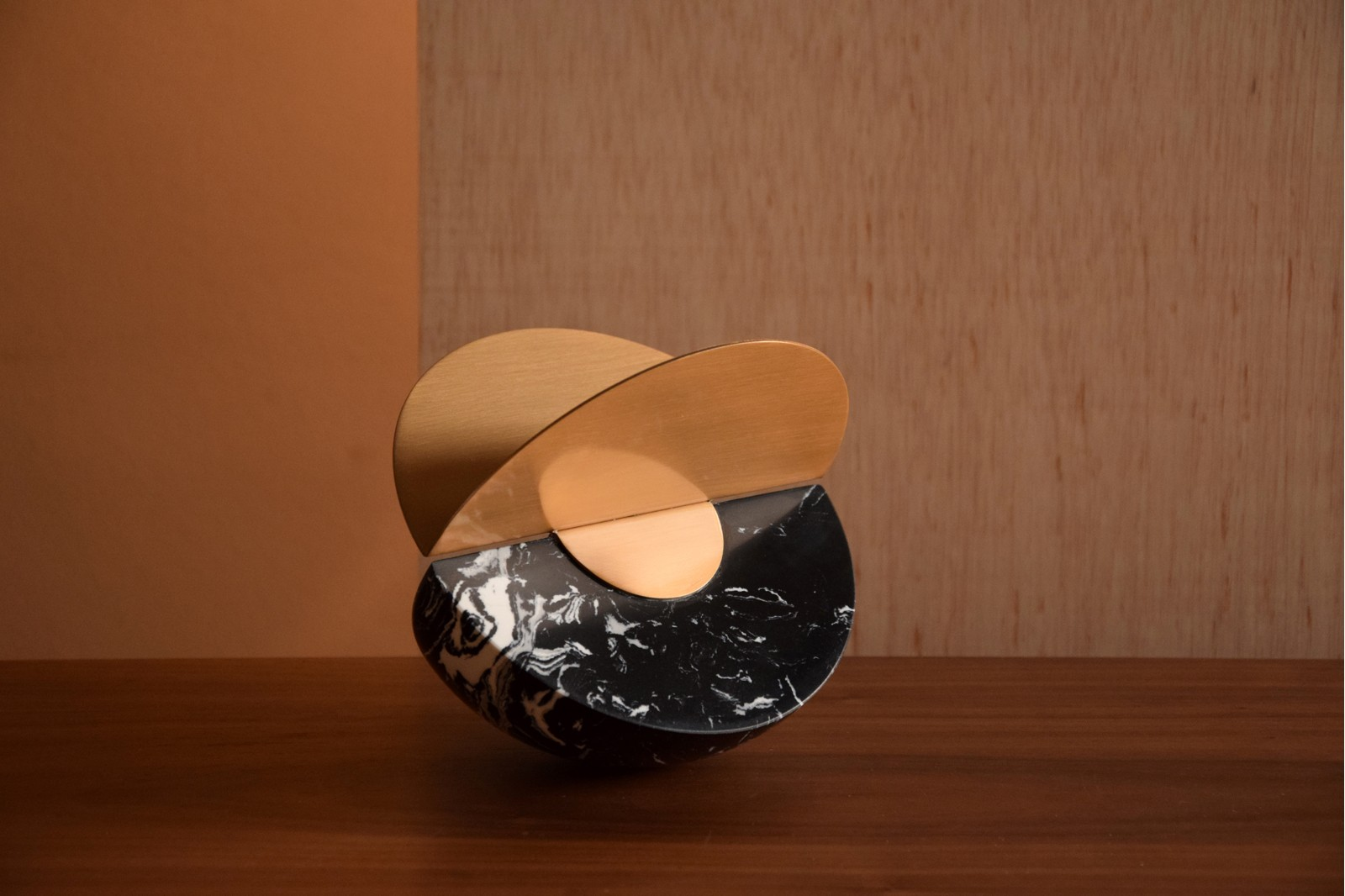 SPHERE COLLECTION. BLACK MARBLE AND METAL SCULPTURE