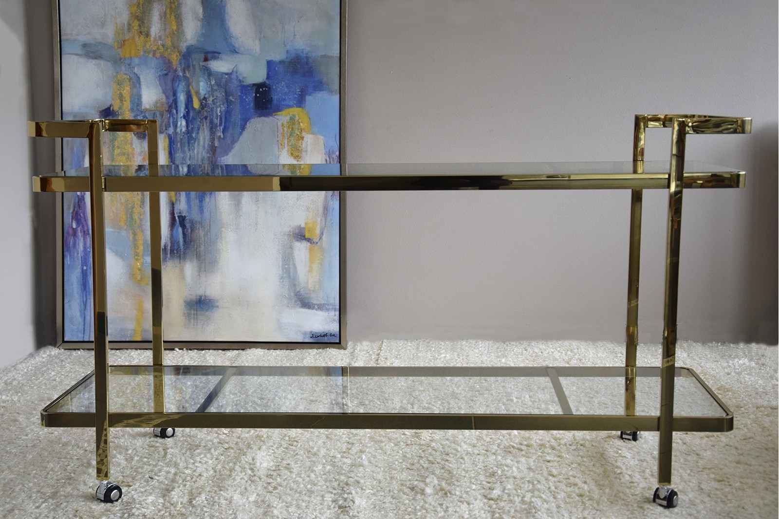 GOLDEN STAINLESS STEEL AND TEMPERED GLASS CONSOLE