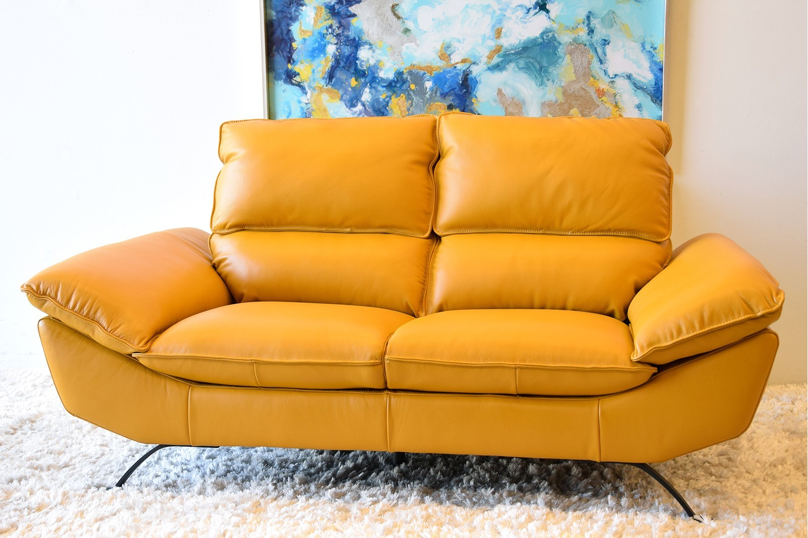 LEATHER SOFA IN MUSTARD COLOR . 2 SEATER
