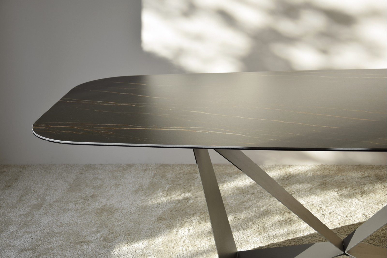 DINING TABLE. CERAMIC TOP AND METAL BASE