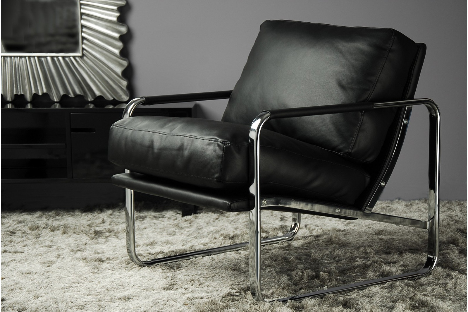 ARMCHAIR. BLACK SYNTHETIC LEATHER. STEEL STRUCTURE