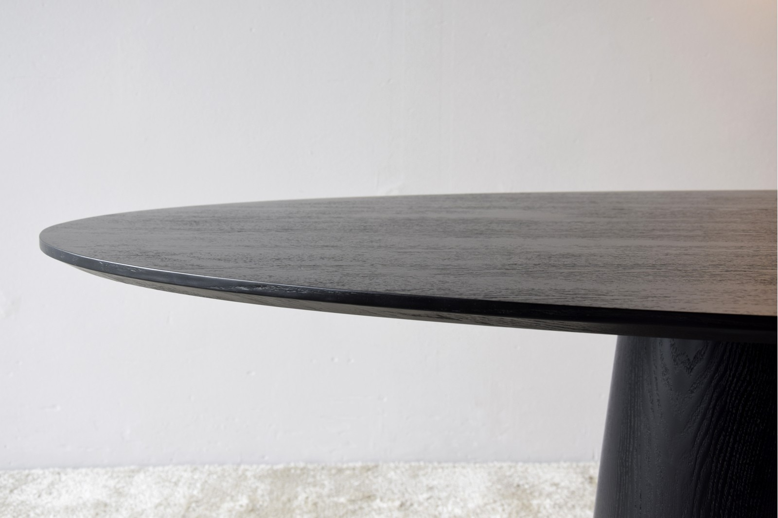 OVAL DINING TABLE. MATT BLACK ASH VENEER.