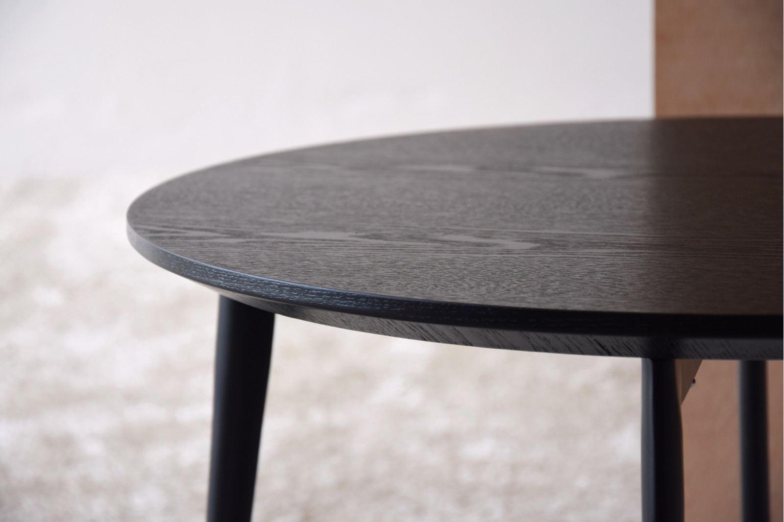 ROUND SIDE TABLE. MATT BLACK ASH VENEER.